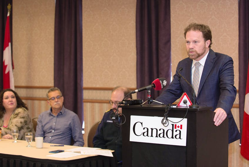 Scott Simms, MP for Coast of Bays-Central-Notre Dame, announced Jan. 17 that work to remove oil from the sunken freight Manolis L is scheduled to begin soon. A request for proposals process is open to marine salvage companies to carry out the task. The announcement was a welcome surprise and relief for Manolis L Citizens' Response Committee co-chairs Carolyn Parsons (far left) and David McConkey, who actively fought for this change for over four years