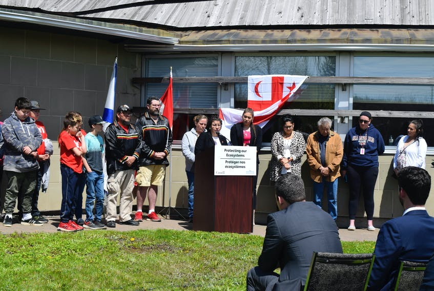 Pictou Landing First Nation Chief Andrea Paul speaking after the federal government announces $100 million investment in Boat Harbour remediation with her council and community beside her.