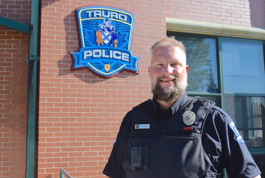 Truro Police Cpl. Judd Hall, seen wearing a body camera, is supportive of a pilot project currently under way and believes the time has come for all officers to be wearing them.