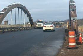 Traffic flows over the new bridge over the Nappan River. The province announced Monday the bridge will be named in honour of former Nova Scotia Premier Roger Bacon. The bridge ends a two-year detour put in place in December 2017 after the former Rainbow Bridge failed an inspection.