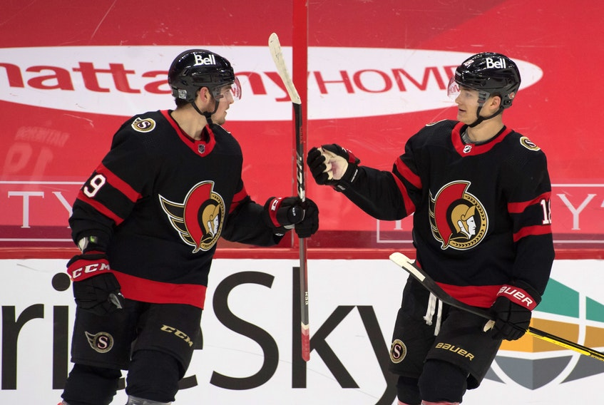 Ottawa Senators winger Drake Batherson (19) of New Minas celebrates with linemate Tim Stutzle (18) after scoring against the Calgary Flames in Ottawa. Batherson is one short of tying franchise record of goals in six straight games. - Marc DesRosiers / USA Today Sports