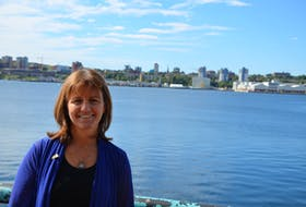 Bonnie Sutherland, executive director of the Nova Scotia Nature Trust, stands on the deck of a Dartmouth restaurant after an September 2020 announcement.