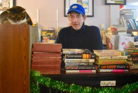 Ed Gillis, owner of Ed's Books and More, is moving his downtown Sydney used bookshop to another site further up Charlotte Street. And his two cats, Mittens and Shadow, are moving with him. Gillis pondered closing the store for good after being told earlier this year that he would have to abandon the premises he has occupied for the past seven years to allow for the construction of Nova Scotia Community College's new downtown campus.