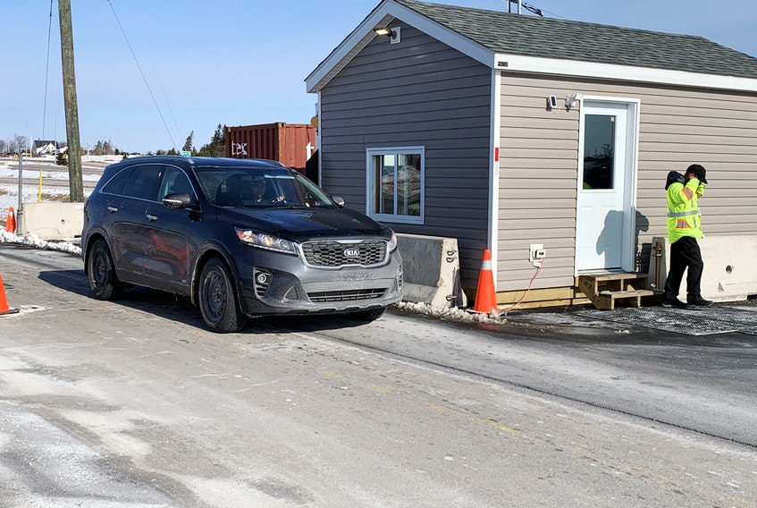 A vehicle is checked at the Nova Scotia border control point at Fort Lawrence early Saturday. While some speculated Nova Scotia's decision to reopen the border a month ahead of the Atlantic bubble's re-established would lead to heavy traffic, New Brunswick has maintained the status quo, requiring people entering that province from Nova Scotia to self-isolate for 14 days.