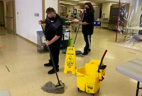 The Horizon Achievement Centre may be soon moving into a brand new building, but that's not keeping maintenance workers from keeping things clean and tidy at centre's present home on Upper Prince Street in Sydney. Above, the centre's Troy Adams, left, mops the floor while fellow maintenance crew member Jamie Spears works the broom on Monday afternoon. The Horizon Achievement Centre, which offers vocational training and employment development services for adults with intellectual disabilities, is expected to move into its new $6.4-million complex this coming autumn.