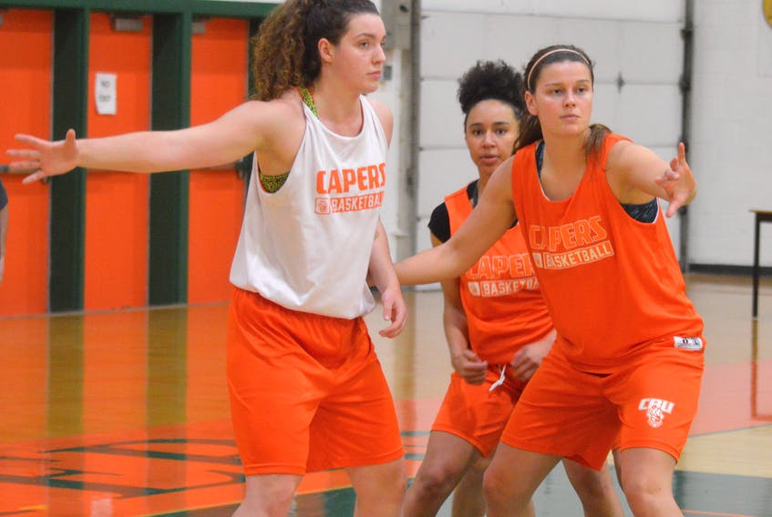 Alison Keough, right, is seen with teammates Sarah Hiscock, left, and Alexus King during practice this week at CBU's Sullivan Field House. CAPE BRETON POST PHOTO