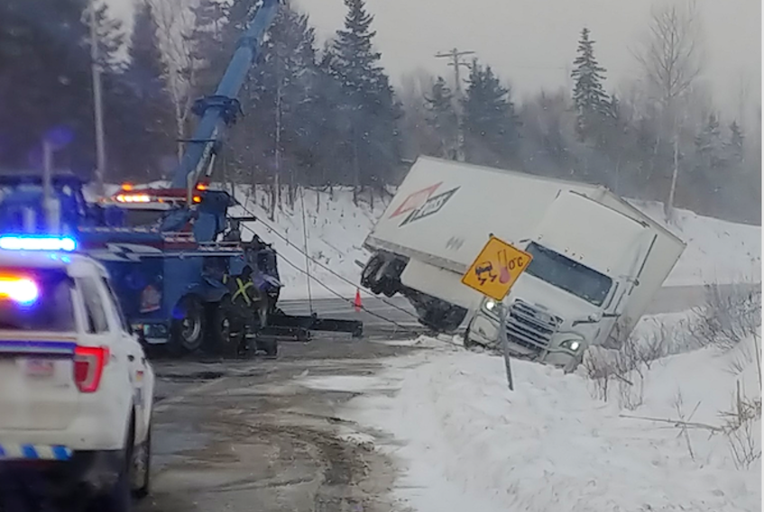 RCMP assist with a vehicle off the road near the Seal Island Bridge Wednesday morning. RCMP say there were five accidents on Highway 125 within 15-20 minutes of each other likely attributed to black ice.