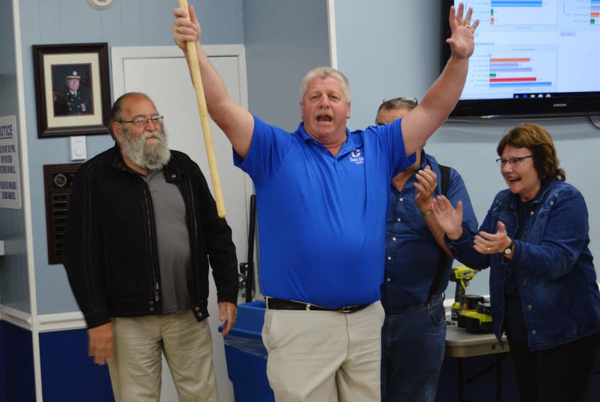Former Progressive Conservative MLA Eddie Orrell waves a broom to represent the Tory sweep in three Nova Scotia byelections on Tuesday: Sydney River-Mira-Louisbourg, Northside-Westmount and Argyle-Barrington.