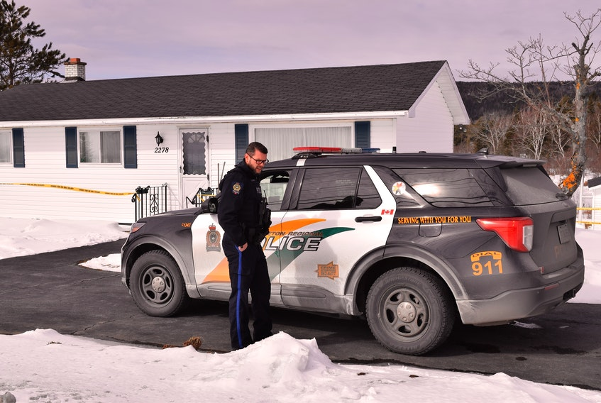 Const. Brett Bursey of the Cape Breton Regional Police Service is shown onthe scene at 2278 Kings Road in Howie Centre Friday afternoon, where a 71-year-old woman was found dead Friday morning and a 73-year-old man was taken into custody. Police say they were called to the Howie Centre residence at 8 a.m. regarding a domestic incident.