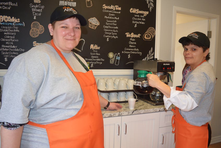 Melissa Banks, left, and Sherry Smith are among the smiling faces that greet visitors to the new café now open in the newly expanded Breton Ability Centre Learning and Employment Centre. In addition to the café, the centre hosts a number of other ventures including a clothing boutique where residents can further develop their skill sets.