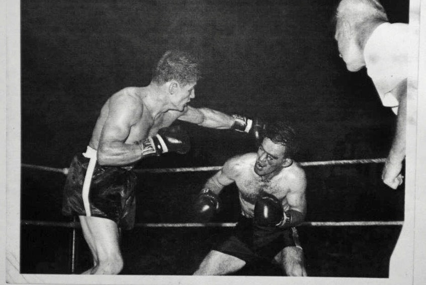 "Tyrone Gardner (right) is shown versus Fernand ""The Bull"" Chretien with Bob Beaton referee."
