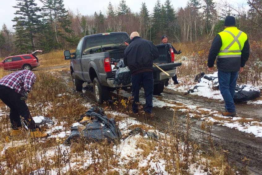 A work crew, including one inmate of the Cape Breton Correctional Facility, cleans up an illegal dumpsite with Cape Breton Regional Municipality solid waste staff and the police officer in charge of investigating these sites, Arnold McKinnon, in a wooded area close to Florence. Since June 2019, some inmates have been able to take part in a community outreach program which involves them working on teams with staff from corrections to help non-profit organizations and with community cleanups. Inmates have to apply to be a part of the program, which helps them develop skills and confidence, leading to greater success after release. The Cape Breton Correctional Facility is currently the only place offering this program in Nova Scotia.
