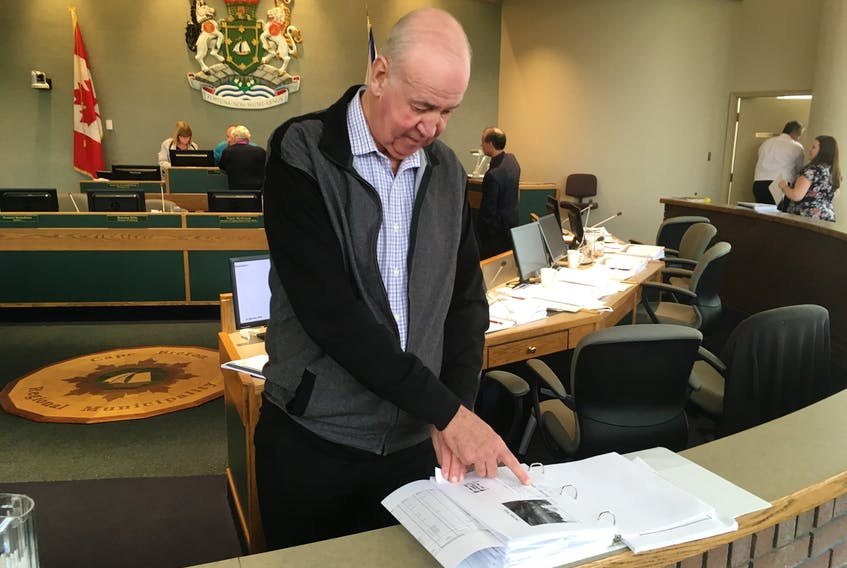 CBRM councillor Ray Paruch points to a list of municipal roads for which there are no funds set aside in the 2018-2019 capital budget. Paruch and other councillors expressed frustration about the lack of financial resources available to the financially strapped municipality. Council approved the $34-million capital budget by a 7-6 vote on Tuesday at city hall.