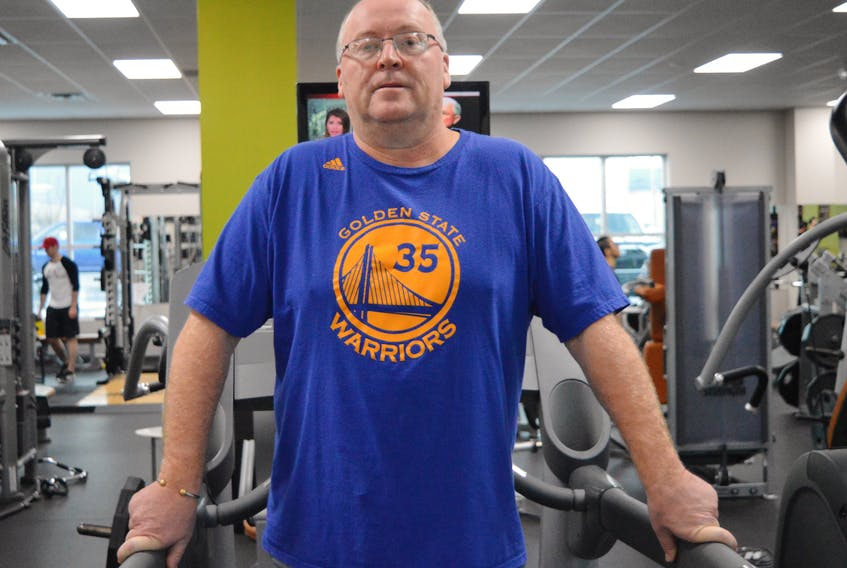 Donat Arsenault of Sydney is seen at Ascendo Fitness on Friday. Arsenault is among many Cape Bretoners who are making their new year's resolutions to be healthier and live an active lifestyle.