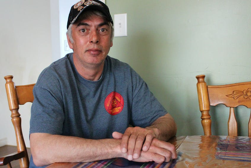 Donald Morrison sits at the kitchen table of his home in Eskasoni. His daughter, Terrilynn Poulette, went missing in 2005 when she was 17 and her remains were found about 10 months later on one of the islands near the First Nation. He's hopeful the Missing and Murdered Indigenous Women and Girls inquiry findings will instigate change in how police investigate the disappearance of Native people and how authorities communicate with their families.