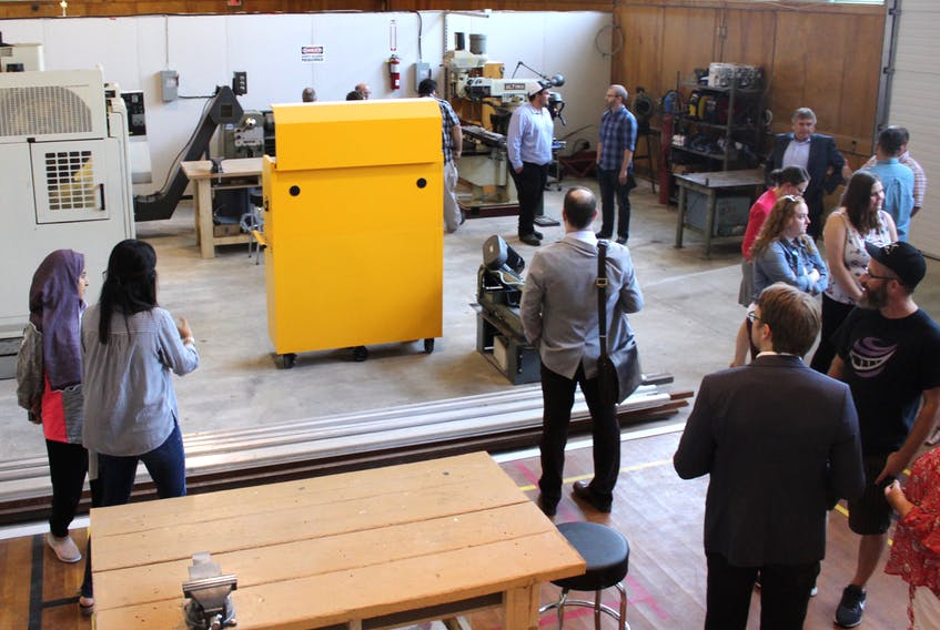 The gymnasium of the former Holy Angels High School has been divided into sections to keep the Nova Scotia Power Makerspace's heavy machinery out of view of the work spaces dedicated to youth programming.