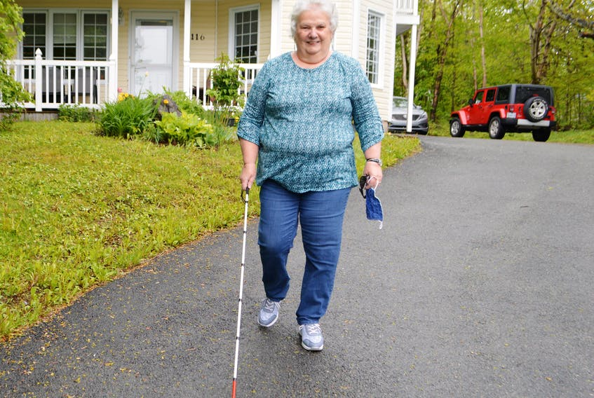 Louise Gillis of Sydney, president of the Canadian Council of the Blind, goes for a walk near her home. Gillis said regulations and policies in conjunction with the COVID-19 crisis need to include people with disabilities.