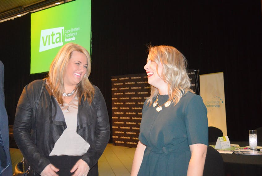 Kathleen Yurchesyn, right, stands with Danielle Patterson, the friend who nominated her for a 2017 Vital Cape Breton Excellence Award. The two are pictured above during the ceremony for the award winners at Centre 200 on Friday night. CHRISTIAN ROACH/CAPE BRETON POST