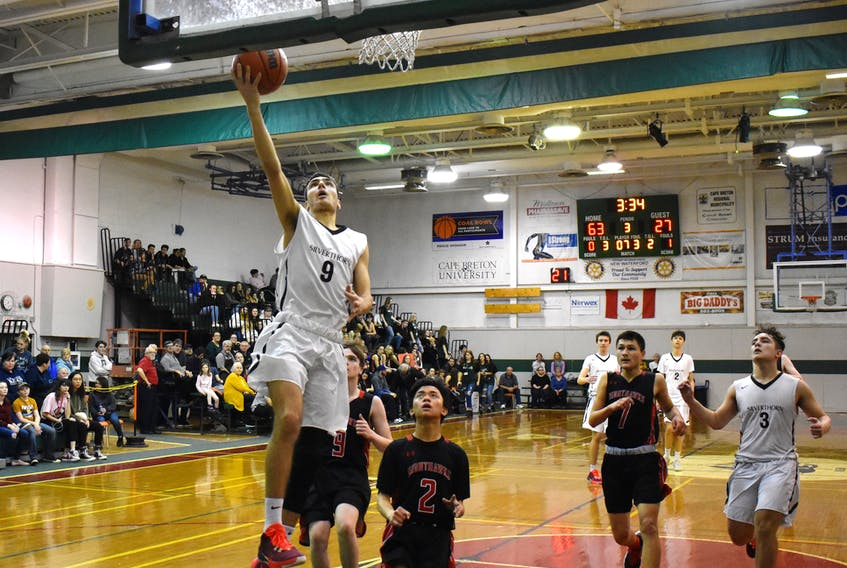 Andrej Curasev of the Silverthorn Spartans, left, goes for a layup as members of the Nothumberland Nighthawks watch during the championship game of the New Waterford Coal Bowl Classic on Saturday. Silverthorn won the game 85-54.