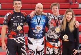 Four Cape Breton fighters captured medals at the Maritime Open Brazilian Jiu-Jitsu tournament, held Sept. 28  in New Glasgow. Tyler Jennings won gold in the 161-175-pound beginners division, while Mark McLanders picked up the gold medal in the 161-175-pound intermediate class. Hailey Boutilier won silver in the beginner open women's weight division, and Jimmy Hall took home the bonze medal in the 215-plus advanced division. From left, Jennings, Hall, McLanders and Boutilier. PHOTO SUBMITTED/JIMMY HALL