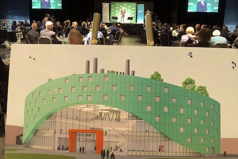 David Dingwall, president of Cape Breton University, centre, is shown at the podium at the Joan Harriss Cruise Pavilion in Sydney on Thursday. In the foreground is a conceptual drawing of the proposed Centre for Discovery and Innovation.