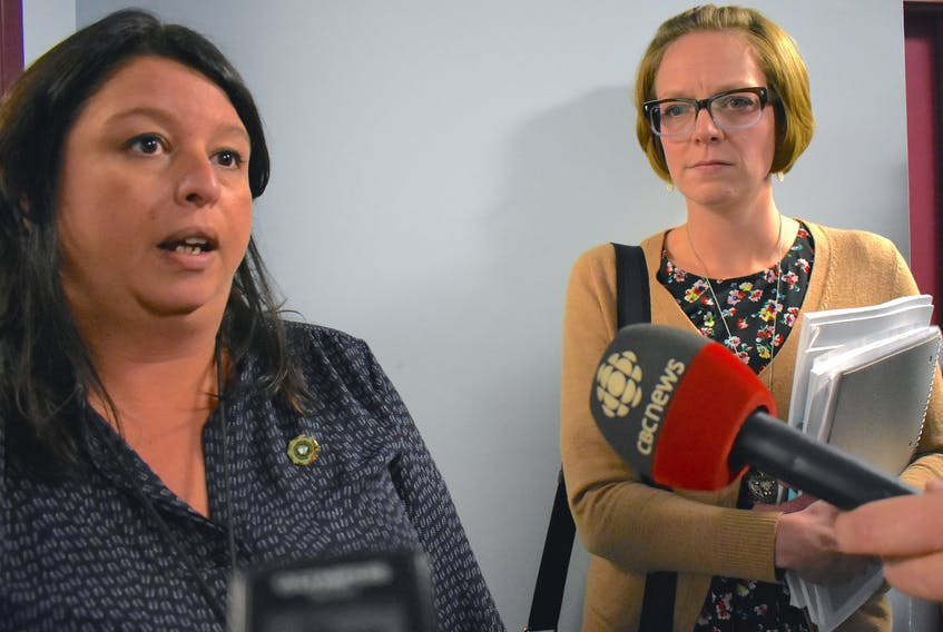 Cape Breton Regional Municipality councilors Earlene MacMullin, left, and Amanda McDougall talk outside of council chambers Tuesday. Both representatives walked out of an in camera meeting that was ostensibly about the mayor's recent trip to China and McDougall's criticisms. Cape Breton Post Photo
