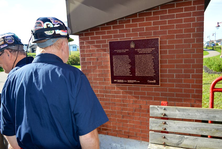 A member of the Men of the Deeps reads the newly unveiled plaque at the Cape Breton Miners' Museum in Glace Bay on Friday that honoured miners who were involved with the Nova Scotia coal strikes of 1922 to 1925. CHRISTIAN ROACH/CAPE BRETON POST