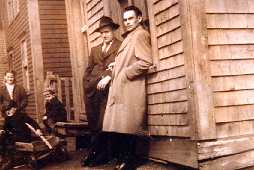 Harold and Nick MacIntosh are seen here in front of Joe Owen's store in Port Morien. Notice the children playing nearby. Submitted photo