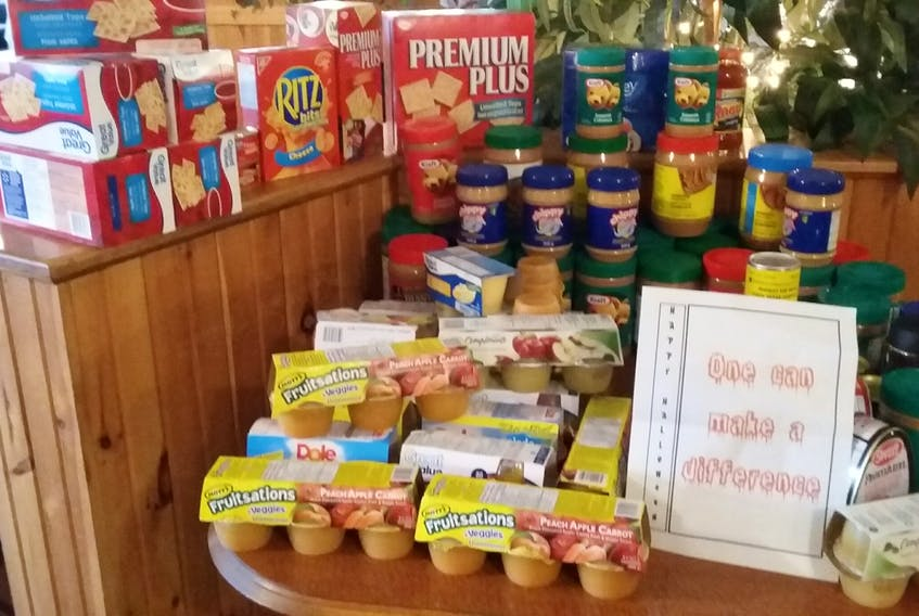 Seen here are donations for the Society of St. Vincent de Paul from a group of New Waterford women.