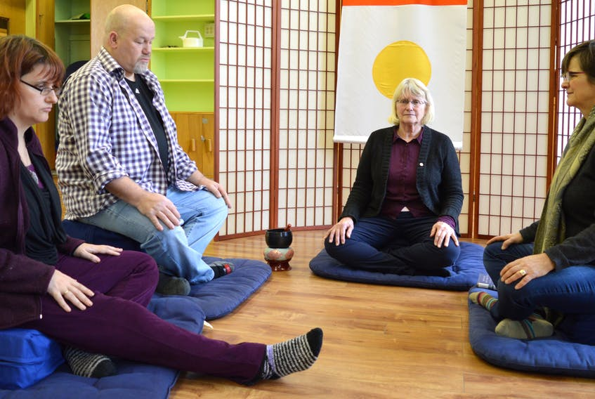 Some of the members of the Sydney Shambhala Meditation group Miriam Saloh, from left, Kenny McGillivray, Catherine Moir and Jean Eyking meditate together. The group, which is part of an international community of meditation centres based on Buddhist philosophy, invites the public to an open house in room 205 at New Dawn Centre fort Social Innovation on Nepean Street in Sydney on Tuesday.