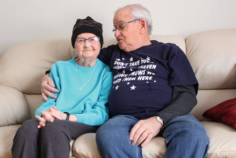 Lois and Adam Lewis sit on the couch at their southend Sydney home. Having undergone surgery in August 2001, Lois is considered the longest living lung transplant recipient in Nova Scotia.