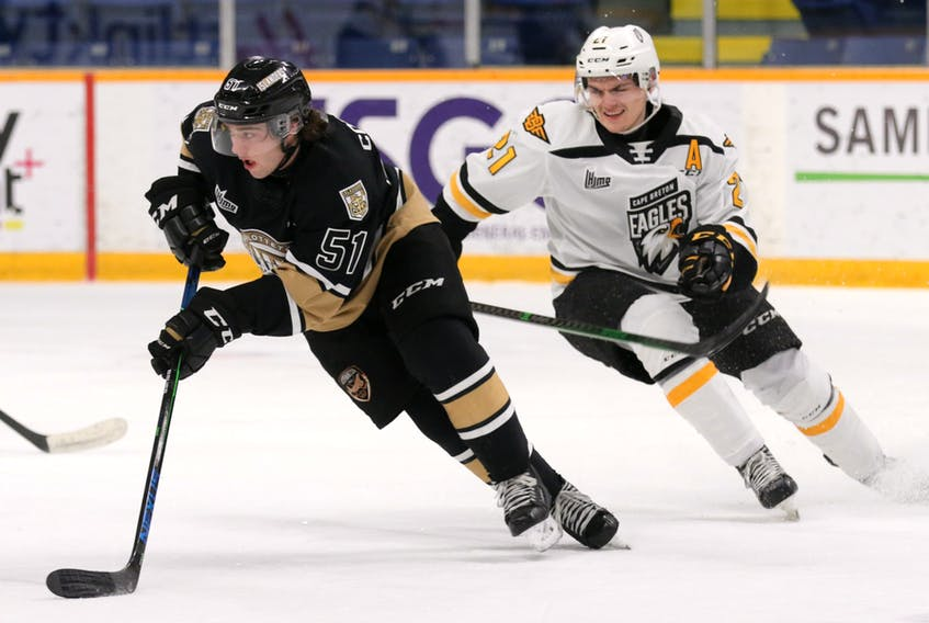 Charlottetown's Lukas Cormier wheels away from Cape Breton's Liam Kidney during the Islanders 4-2 victory over the Eagles on Saturday at Centre 200 in Sydney. Kidney, a Vegas Golden Knights draft selection, scored twice to help lead the Islanders to the win before 1,119 fans.