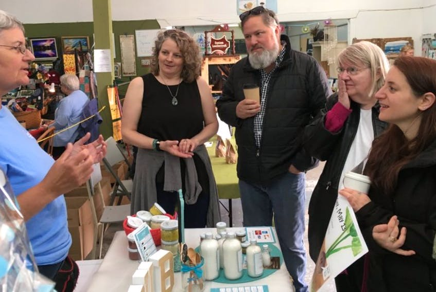 Joan McNeil, from left, of Scrub Inspired, describes the Glace Bay-based company's products as Pauline Singer of the Cape Breton Farmers Market on Keltic Drive leads participants Allen McCormick, Delores MacDonald and Aimee Wilson on a tour to meet vendors and learn about their products as part of the annual Upskilling Food Festival and Conference on Saturday. The four-day festival, which promotes local food, wrapped up Sunday with a full day of workshops at Cape Breton University.