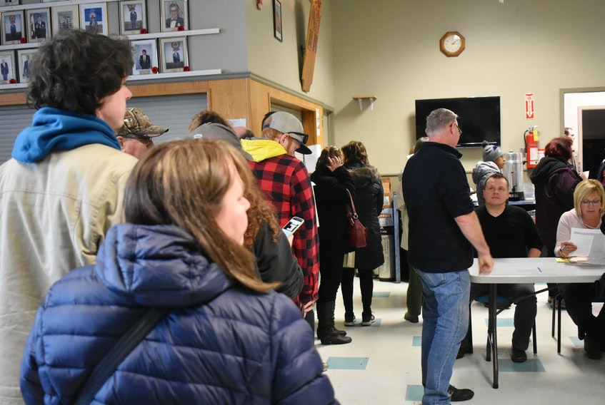 Former ServiCom Canada Ltd. employees line up to hand in financial support forms to Employment Nova Scotia officials during a two-hour information session at the Ashby branch of the Royal Canadian Legion on State Street in Sydney, Friday. Documents filed in U.S. bankruptcy court Thursday indicate ServiCom has no money to pay employees.