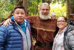 """Tom and Carol Anne Johnson pose with one of the main characters on set in Ireland. Tom Johnson says their first experience on the set of a production was amazing. """"We were in awe,"""" he says."""