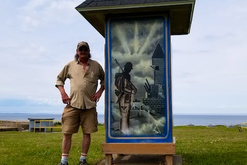 Rob Grezel, volunteer coordinator with the Sydney Fortification Society and operator of the Fort Petrie Museum stands next to a pained mural of a Canadian soldier at Fort Petrie in New Victoria on Friday.