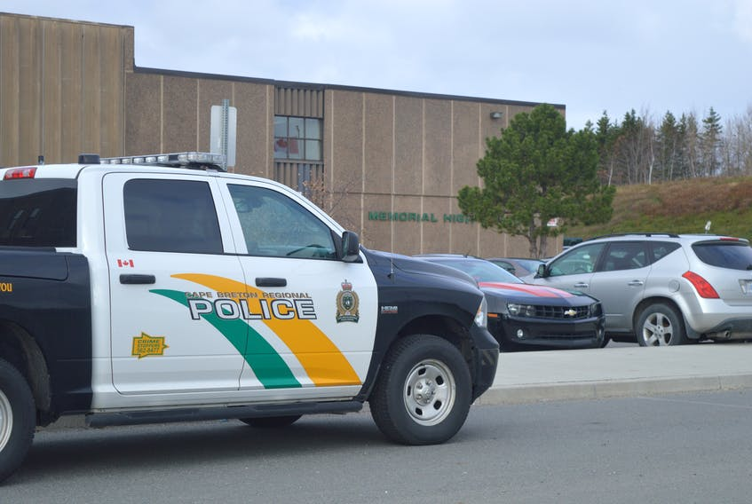 A Cape Breton Regional Police vehicle is shown parked in front of Memorial High School in Sydney Mines on Wednesday. JEREMY FRASER/CAPE BRETON POST