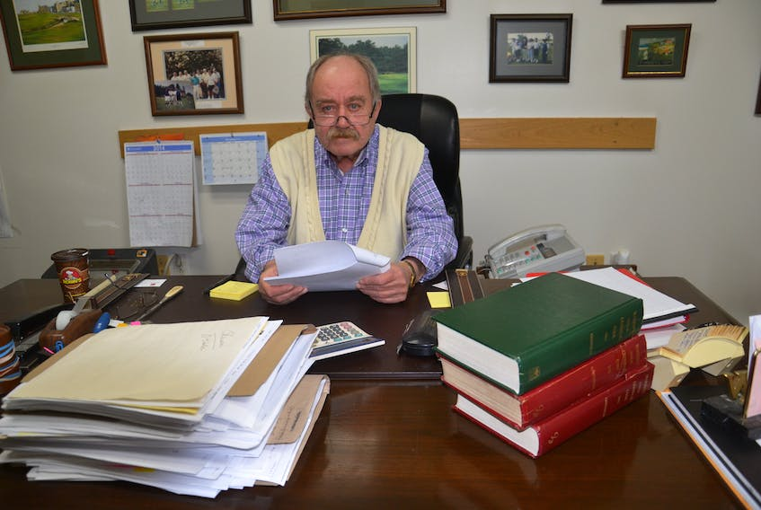 """Defense lawyer Bill Burchell sits at his desk in his Sydney Mines office in this file photo. Burchell said he said he doesn't think the new proposed changes to the impaired driving laws will affect his job much, but he does find the proposal to have mandatory alcohol screening """"offensive."""" CAPE BRETON POST PHOTO"""