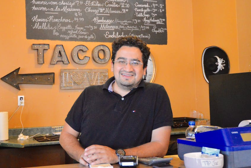 Proprietor Mauricio Horta serves up authentic, homemade-style Mexican food at El Jefe, his new restaurant located in Sydney's Prince Street Market. Horta, who grew up in Mexico City, found his way to the East Coast after meeting a Cape Breton woman in Montréal. DAVID JALA/CAPE BRETON POST