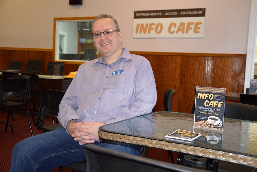 """Pastor Rob Jones sits at a table where the Info Café will happen every Tuesday at Faith Baptist Church on Davenport Street in Sydney. It will be a """"one stop shop"""" for people looking for advice on housing, benefits, relationships, employment and money. There will be free refreshments and one-meal food bags available. NIKKI SULLIVAN/CAPE BRETON POST"""