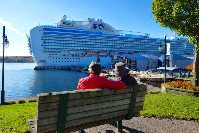 A couple traveling on the 3,000-passenger Crown Princess spend a few minutes reflecting on their visit to Sydney during the port's last day of cruise ship activity on Oct. 29. DAVID JALA/CAPE BRETON POST