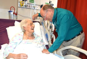 Dr. Peter Littlejohn, a family physician in New Waterford, chats with his patient Beatrice Jensen, 105, on the medical floor of the New Waterford Consolidated Hospital. After 44 years of practising in New Waterford, Littlejohn — who has in excess of 2,000 patients — is retiring at the end of July.