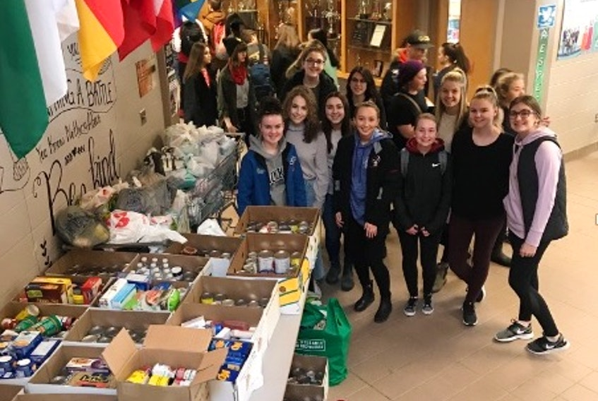Members of the Interact Club collected supplies for the Glace Bay Food Bank. There's a friendly competition among the classes at Glace Bay High to see which group can raise the most food. It's the kind of race that everyone wins.