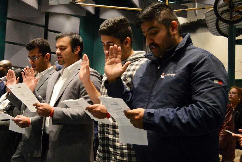 Twenty-four people from 10 countries officially became Canadian citizens during a ceremony at the Alexander Graham Bell National Historic Site on Wednesday. GREG MCNEIL/CAPE BRETON POST