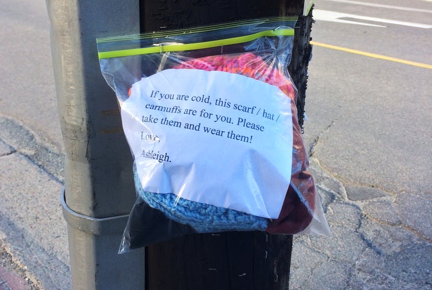 It has become a familiar Christmas offering found on utility poles in various locations across Sydney. Thanks to 14-year-old Ashleigh Hanna and other members of 29 Sydney Kiwanis Air Cadet squadron, those in need have instant access to free hats, mitts, and scarves to keep out the cold of winter.