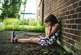 This stock image illustrates the despair felt by a child living in poverty.