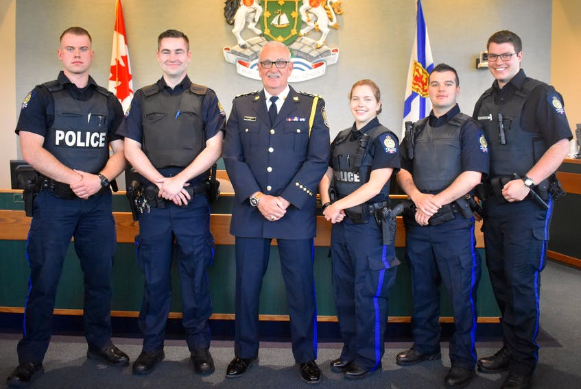 Five new Cape Breton Regional Police Service constables were sworn in on Wednesday at the city hall council chambers. From left: Const. Jesse MacGillivary, Const. Vincent MacKinnon, Chief Peter McIsaac, Const. Shea-Lynn McNeil, Const. Tyler Ross and Const. Logan Aucoin.