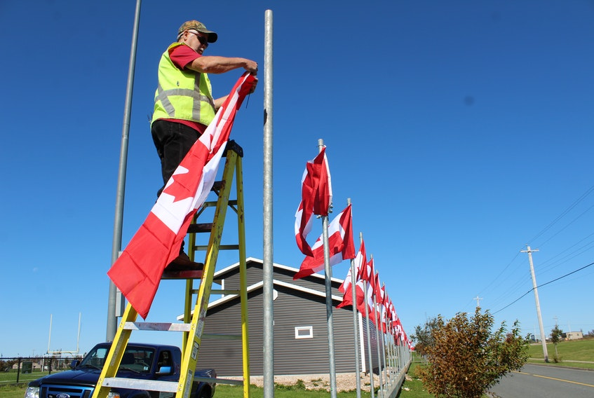 Nova Scotia Lands employee Steve Gillis is shown raising some of the Canadian flags that will be part of the Veterans Voices of Canada Flags of Remembrance ceremony at Open Hearth Park in Sydney recently.Every year, 128 full-size official Canadian flags are raised along major roadways and other highly visible locations in participating communities across Canada. Flags represent the more than 128,000 Canadians Military and RCMP killed or missing in action from the South African War to present day. This year, a tribute was given to first responders during the ceremony. The flags will remain raised until Nov.12.