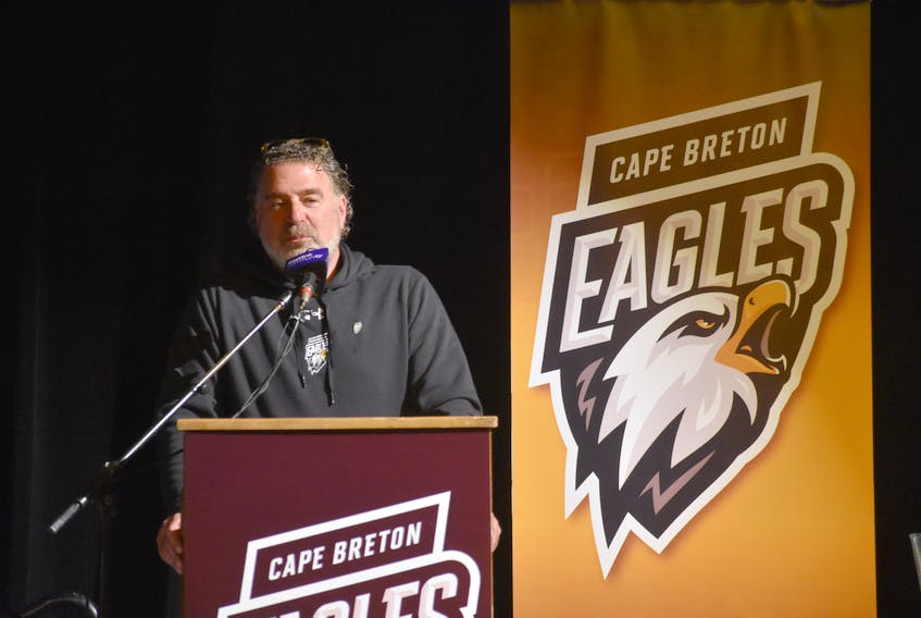 Cape Breton Eagles majority Irwin Simon speaks to the crowd during a team press conference at Centre 200 last Wednesday. Simon says right now he has no intentions to be part of the Cape Breton Highlanders organization, but it's something he would consider.