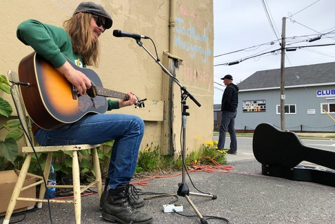 Jordan Musycsyn performs outside of Dr. Luke's Coffee House in Sydney on Thursday. The entertainer was part of the 2019 Celtic Colours International Festival.